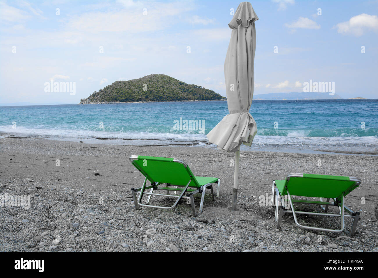 Green seats on the beach - Stock Image