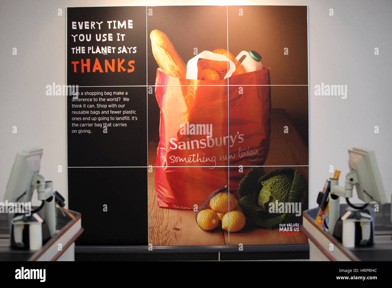 Sainsburys supermarket in Colne , UK. Every Time You Use Us The Planet Says Thanks sign - Stock Image