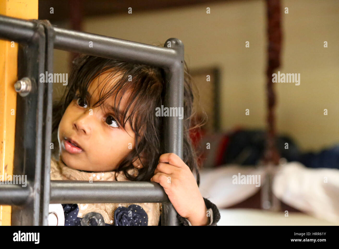 Portrait of an Indian girl on the train, India. - Stock Image