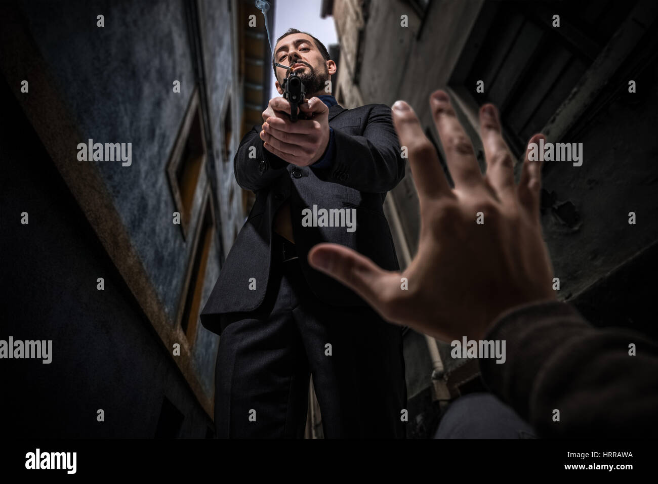 Mafia killer murdering an innocent - Stock Image
