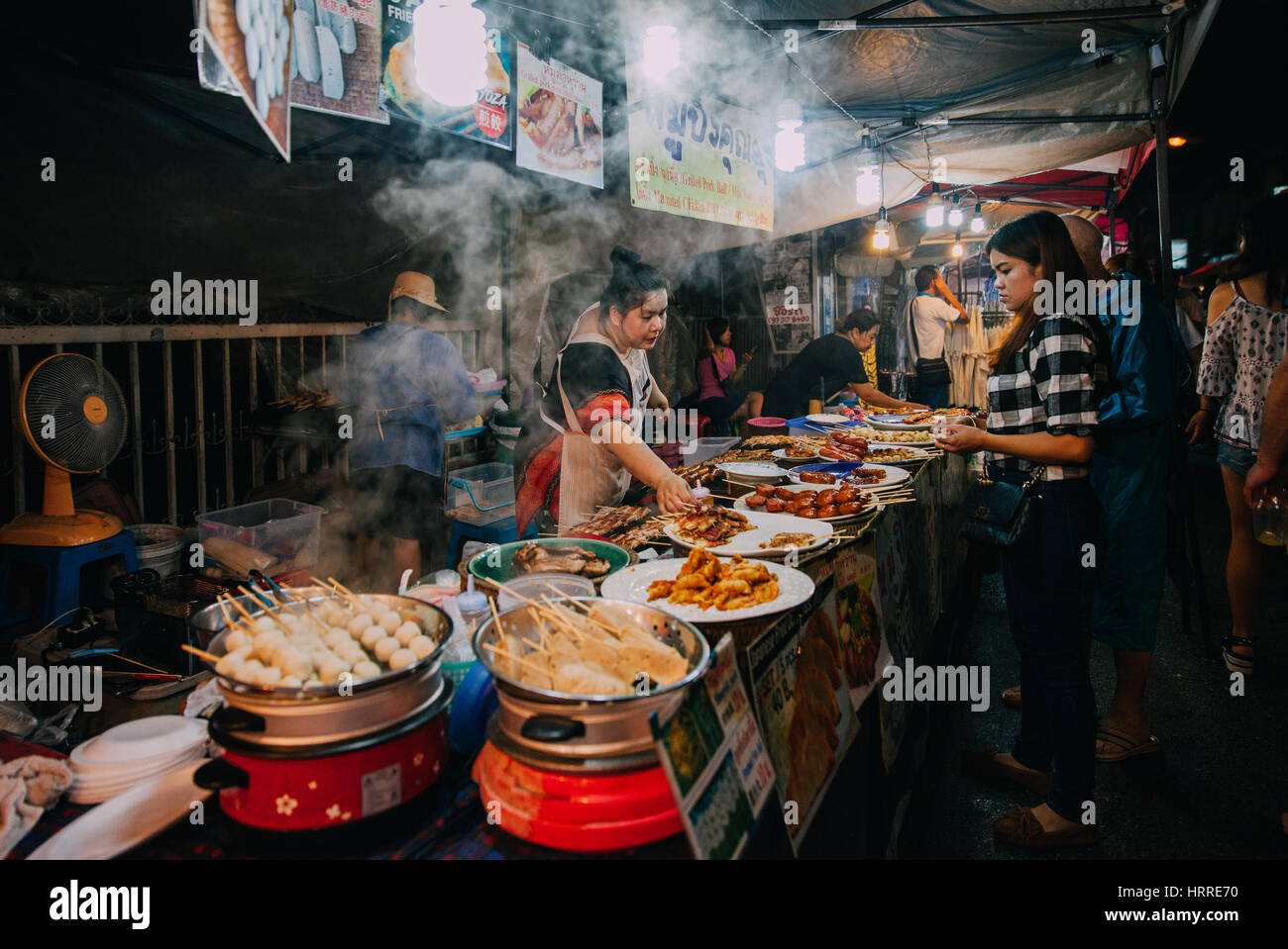 Chiang Mai, Thailand - August 27, 2016:  Thai woman sales at the Saturday Night Market on August 27, 2016 in Chiang - Stock Image
