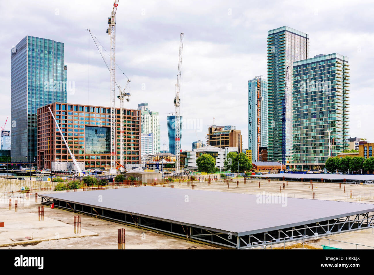 LONDON - AUGUST, 2016: This is a developing area of Canary Wharf financial district where new buildings will be - Stock Image