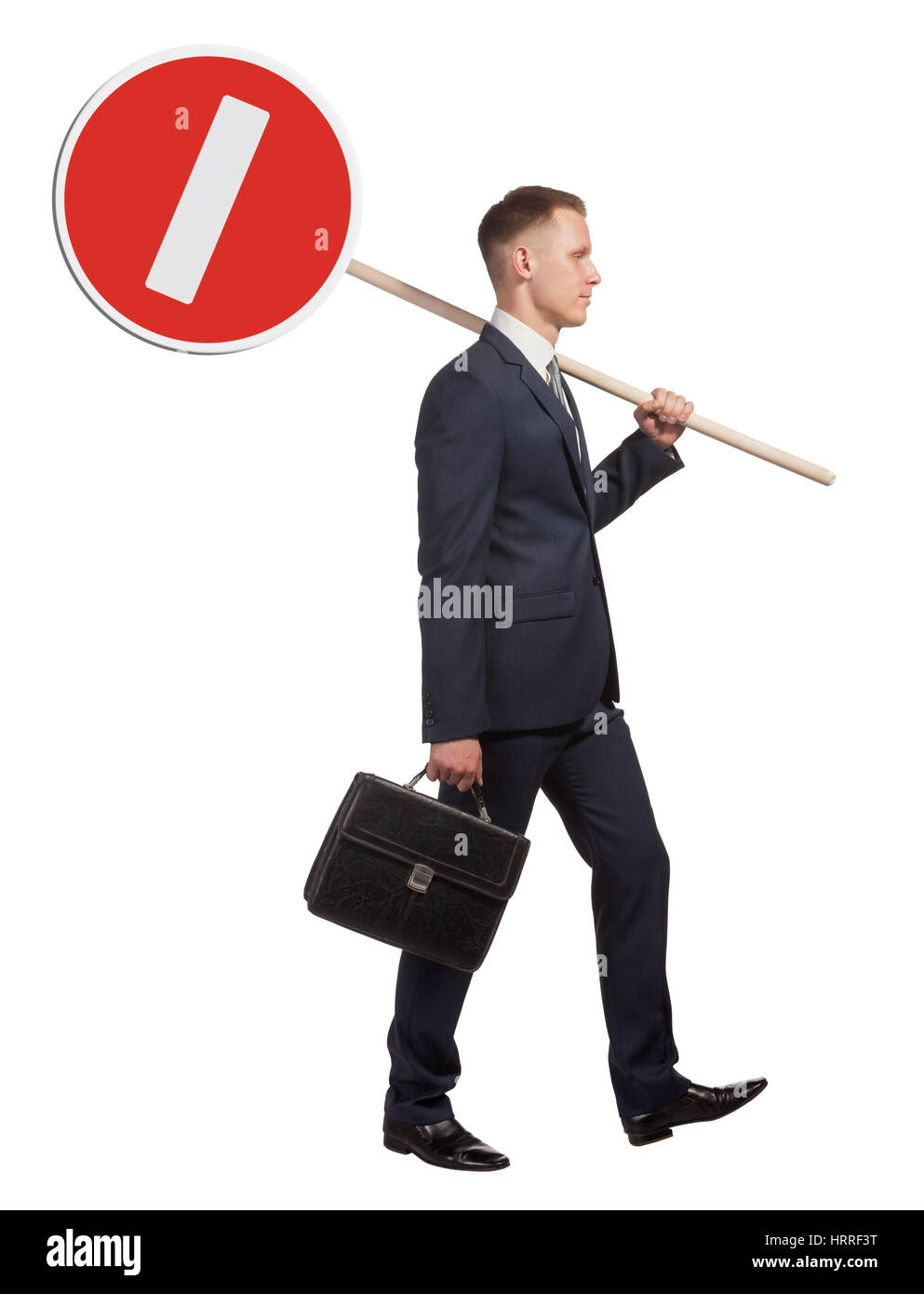 Official man carries a road sign, which means that no entry. Isolated on white background. - Stock Image
