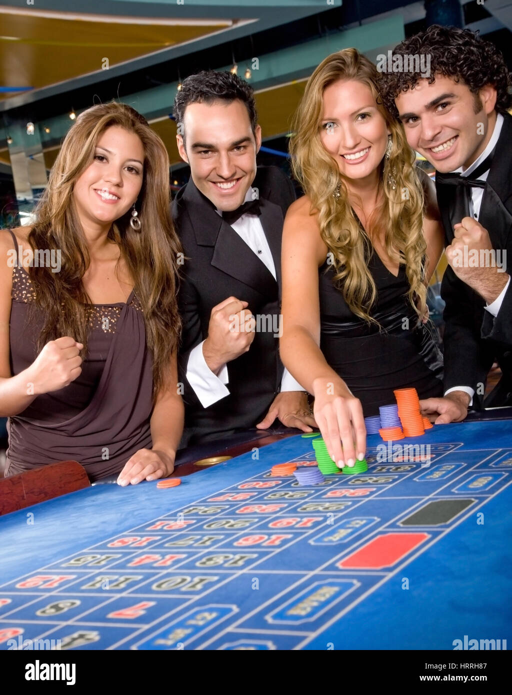 Group of casino gamblers on the roulette - Stock Image