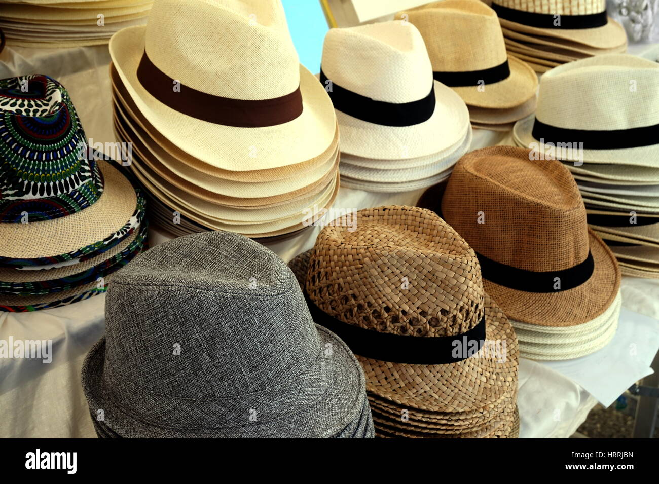 56e8b1d252346e Straw fedora hats for men in varied colors and designs on a market stall -  Stock