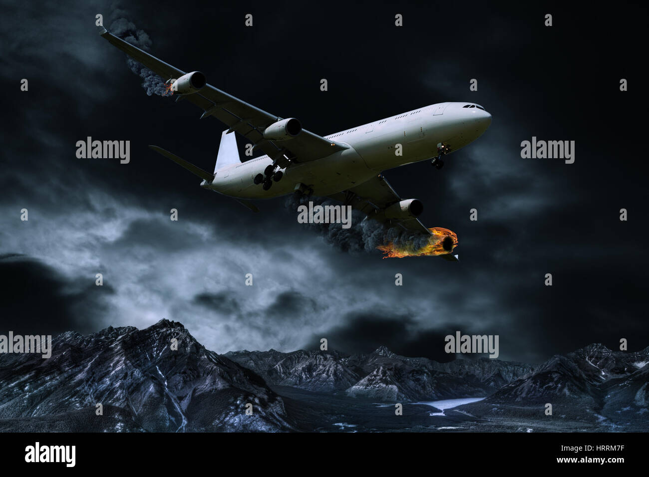 Cinematic portrayal of a fictitious plane in distress flying over mountainous regions with its engines on fire. - Stock Image