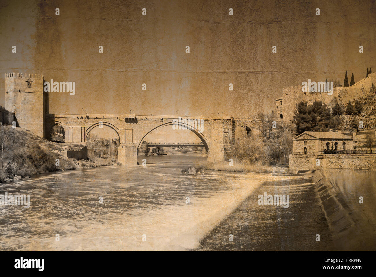Postcard in vintage look of the bridge San Martin at Toledo, Spain - Stock Image