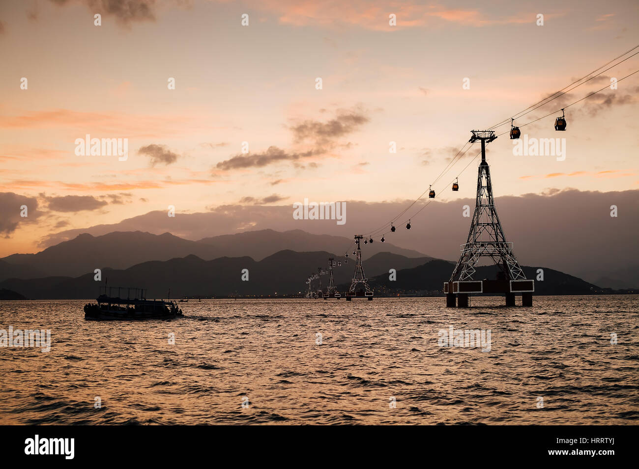picturesque cable way at sunset in Vietnam Nha Trang Vinpearl - Stock Image
