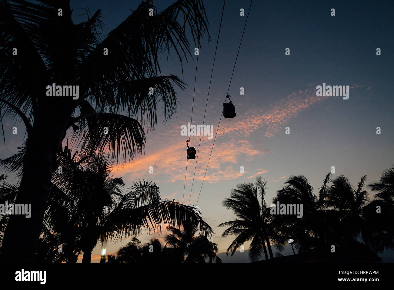 cable way silhouette at sunset twilight in Vietnam Vinpearl - Stock Image