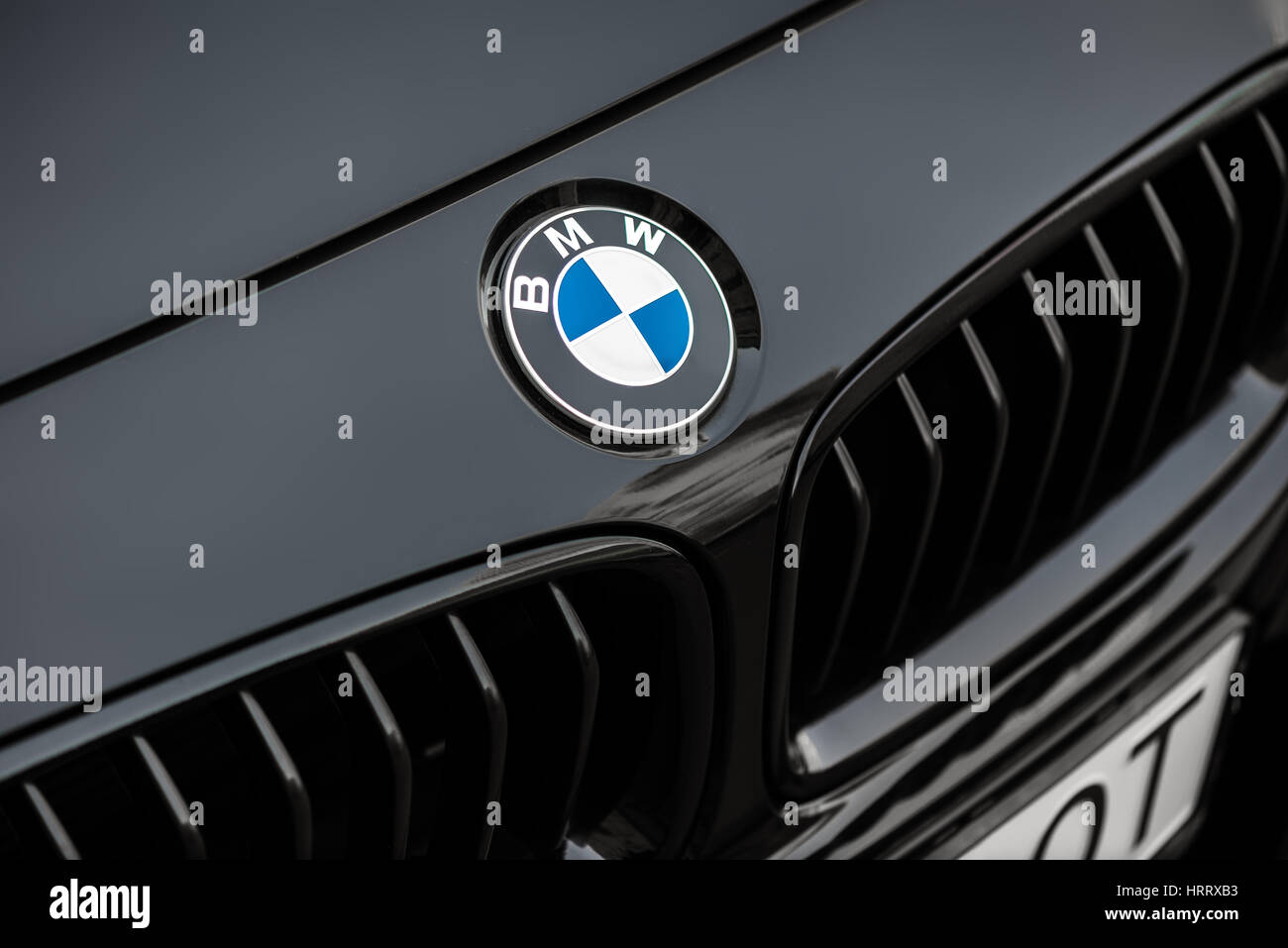 Kyiv, Ukraine - March 4th, 2017: Bmw motor company badge on the front from a black car. BMW is a German automobile, - Stock Image