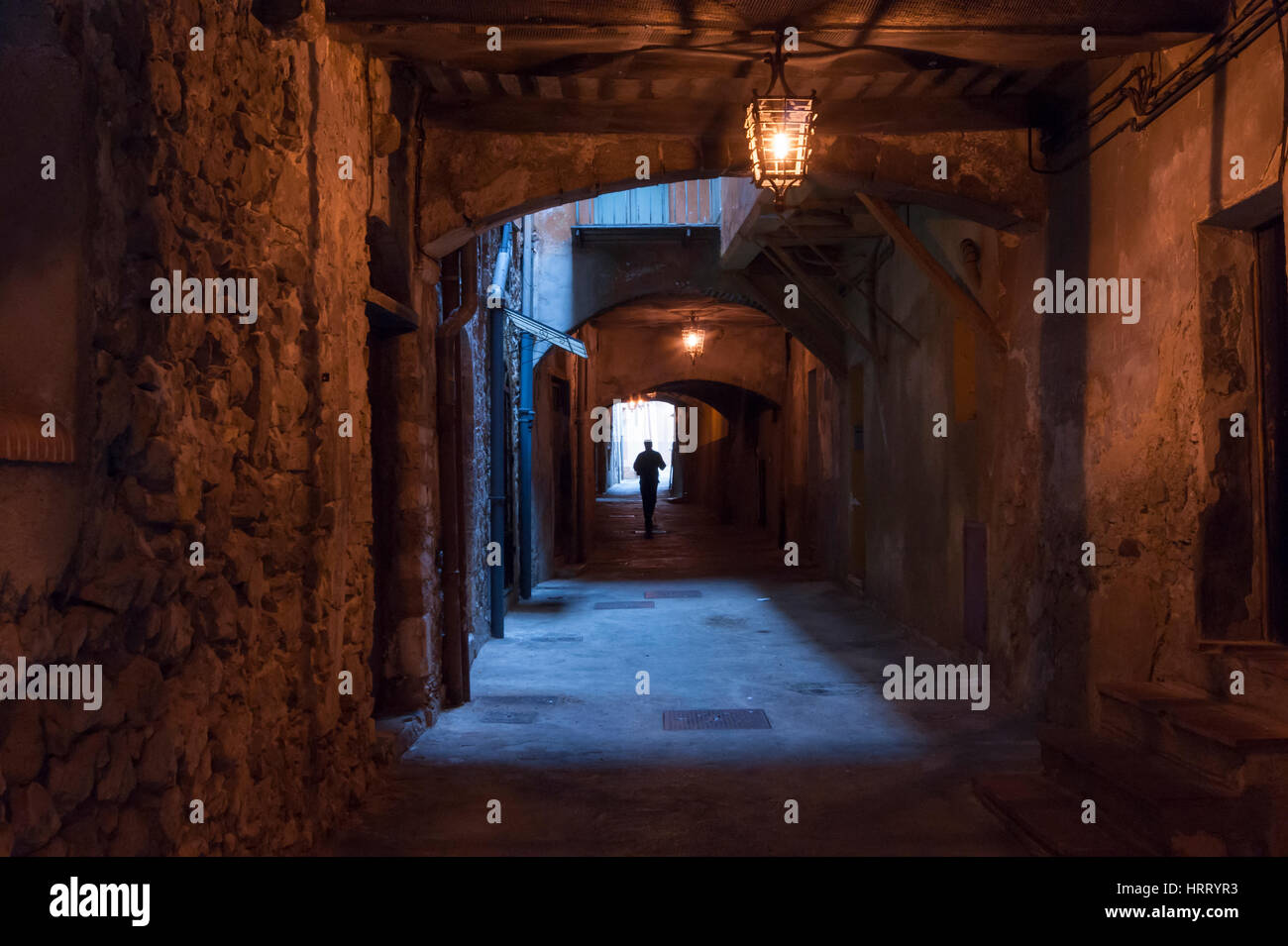View of the medieval Rue Obscure (Dark Street) a listed historical monument in the medieval  heart of Villefranche - Stock Image