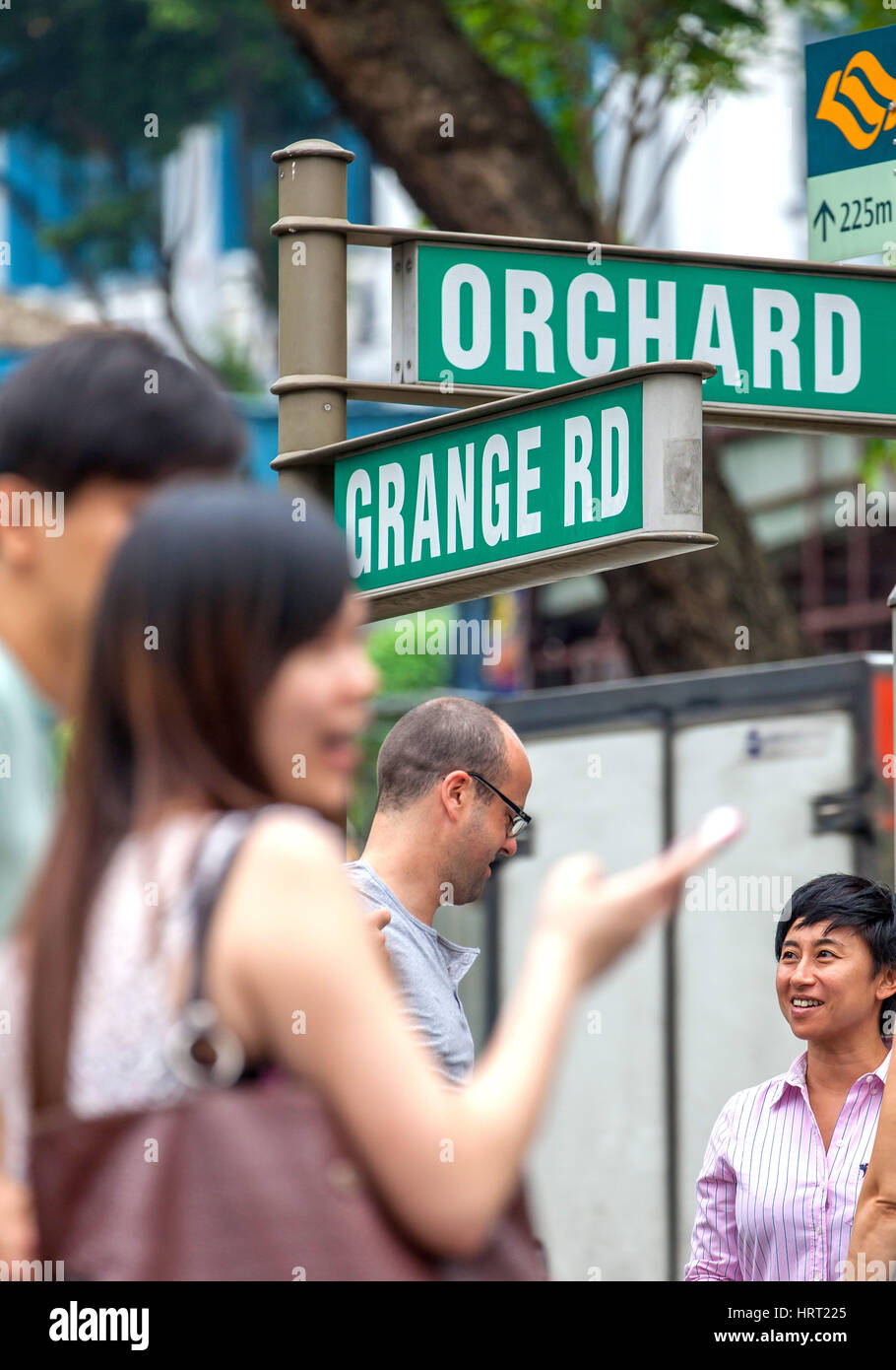 Main road, shopping street Orchard Road, Grange Road, road signs, pedestrians, Singapore, Asia, Singapore - Stock Image