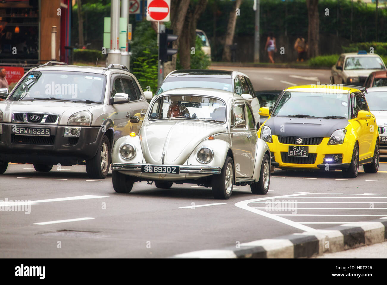 VW Beetle on the streets of Singapore, Singapore, Asia, Singapore - Stock Image
