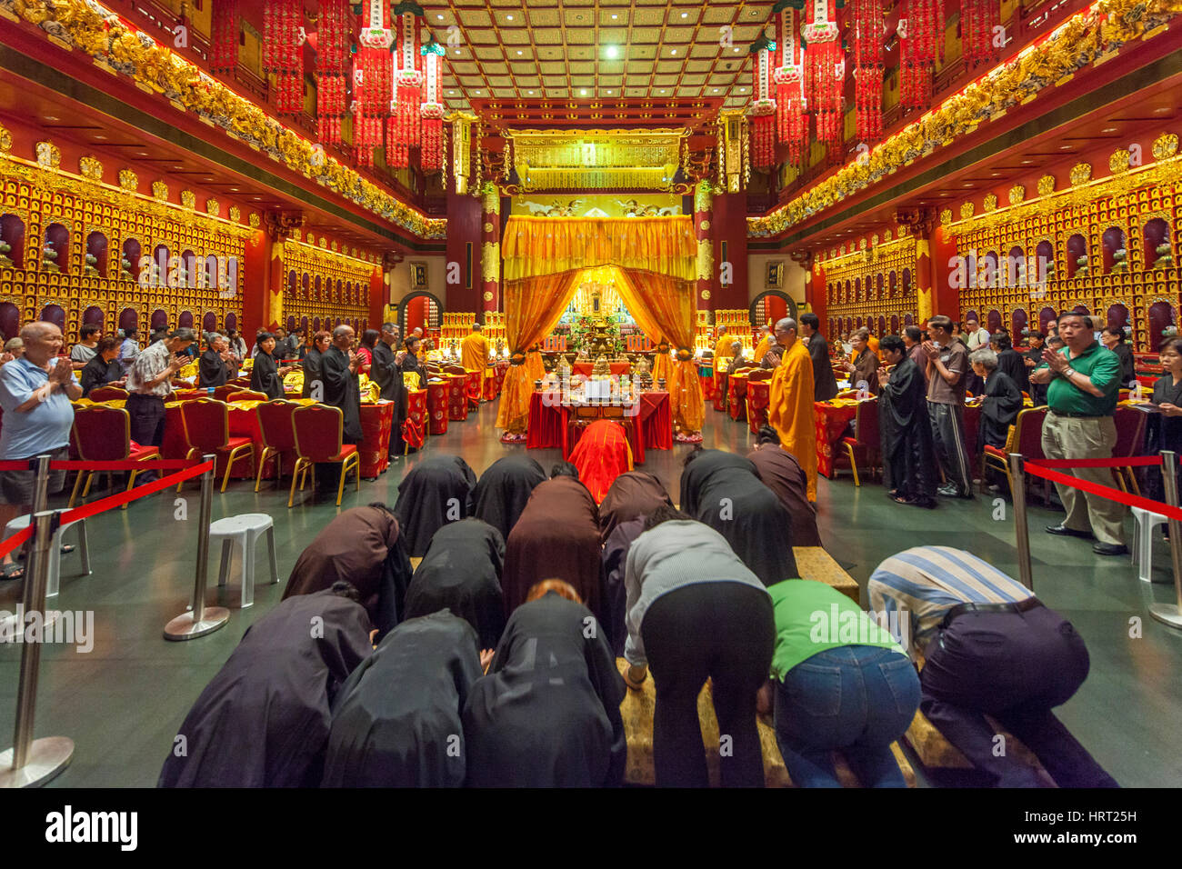 Buddha Tooth Relic Temple, Praying Believer, Religion, Buddhism, Buddha Tooth Temple, Singapore, Asia, Singapore - Stock Image