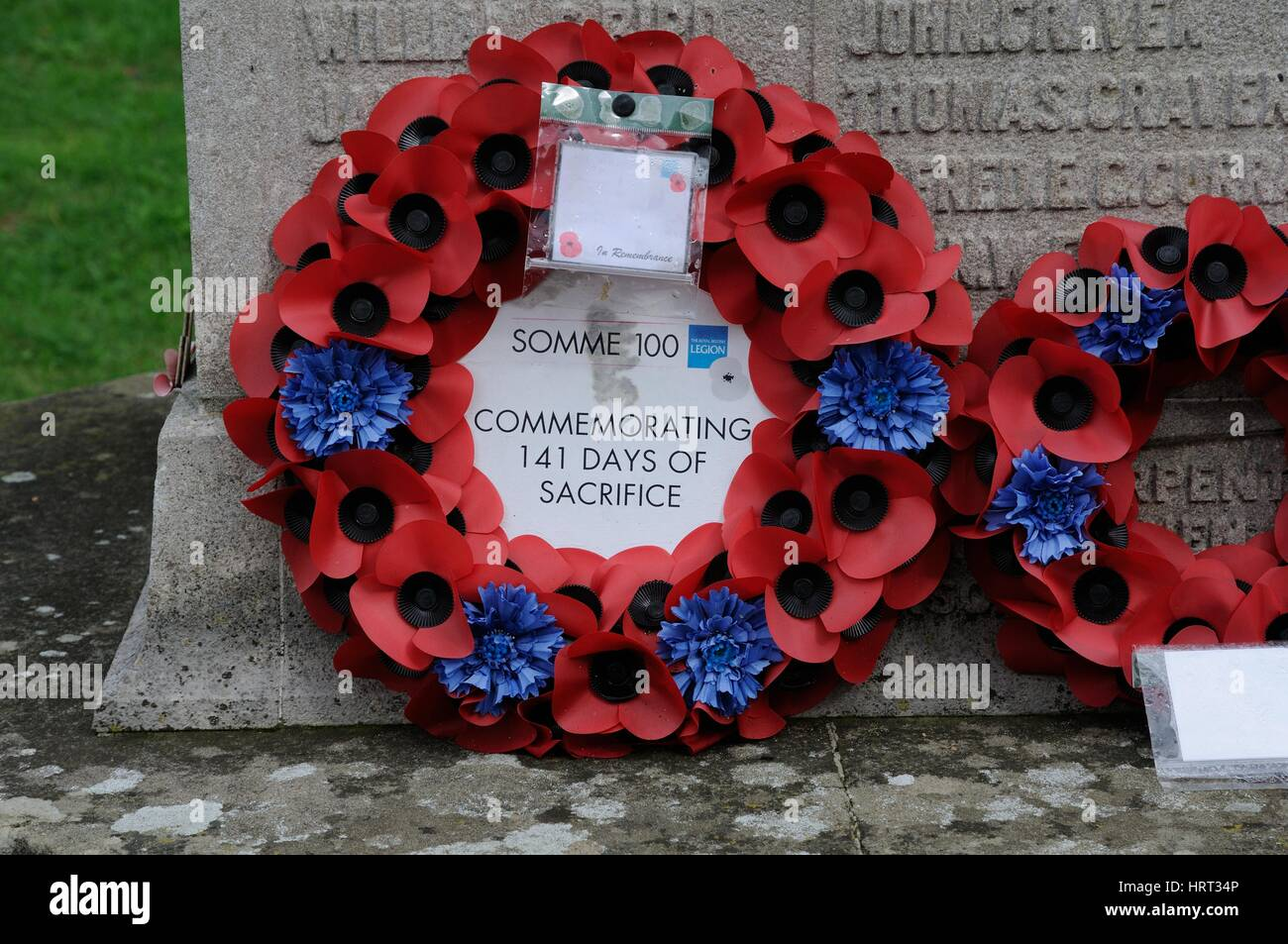 War Memorial, Stanwick, Northamptonshire. Wreath commemorating 100 year anniversary of the Somme and the 141 days - Stock Image