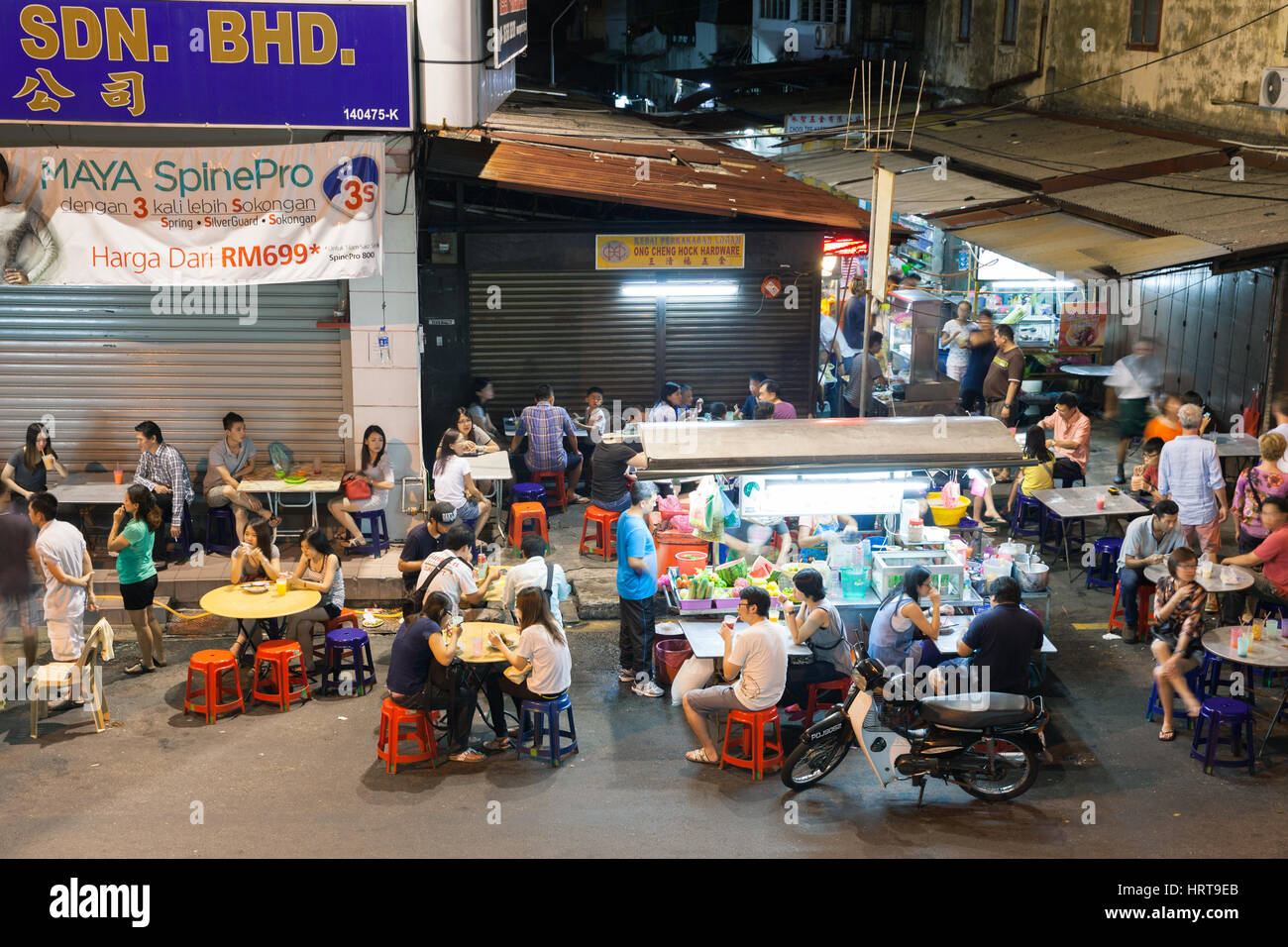 Georgetown, Malaysia - 03 August, 2014: The crowd of people dining at the street food stalls on Lebuh Chulia in Stock Photo