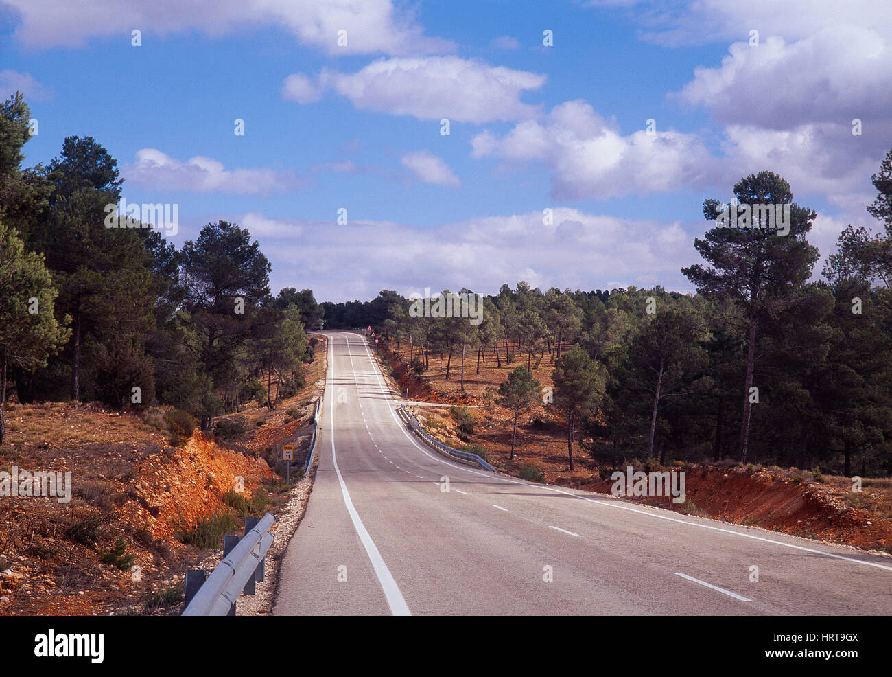 Lonely road. Valencia province, Spain. - Stock Image
