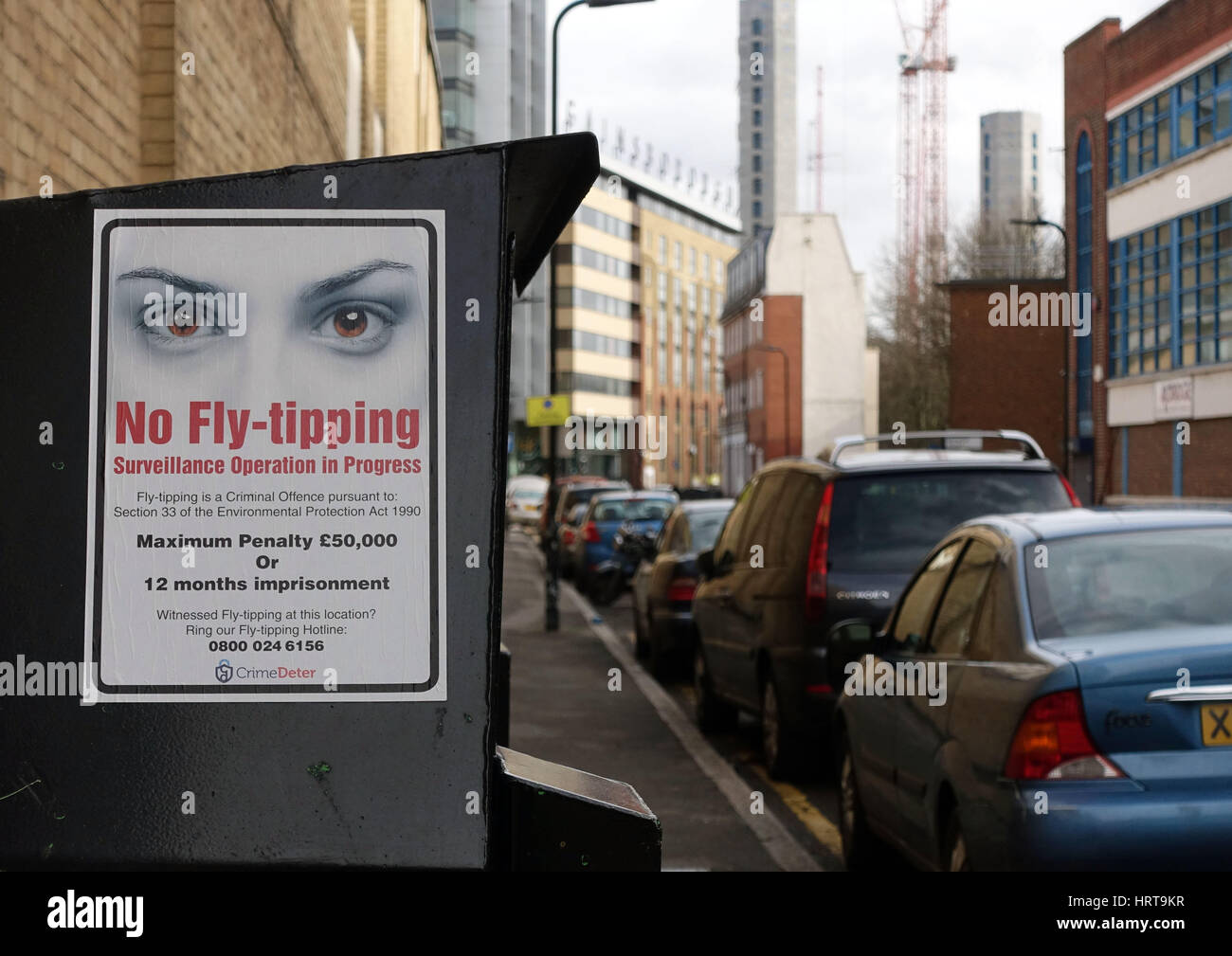 Sign with penalties for fly-tipping in street in Islington, London - Stock Image