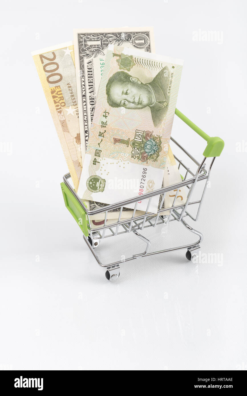 Dollar, Euro and Yuan banknotes in shopping cart / trolley. Metaphor for exchange rates, free trade, trade war, - Stock Image