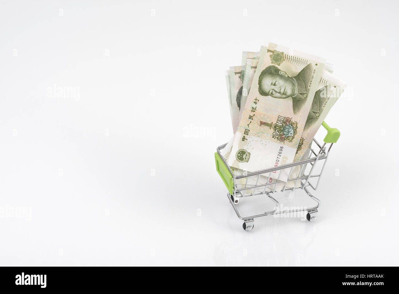 1 Yuan bills / banknotes in shopping cart / trolley against light background. Metaphor for Chinese economy, budget, - Stock Image
