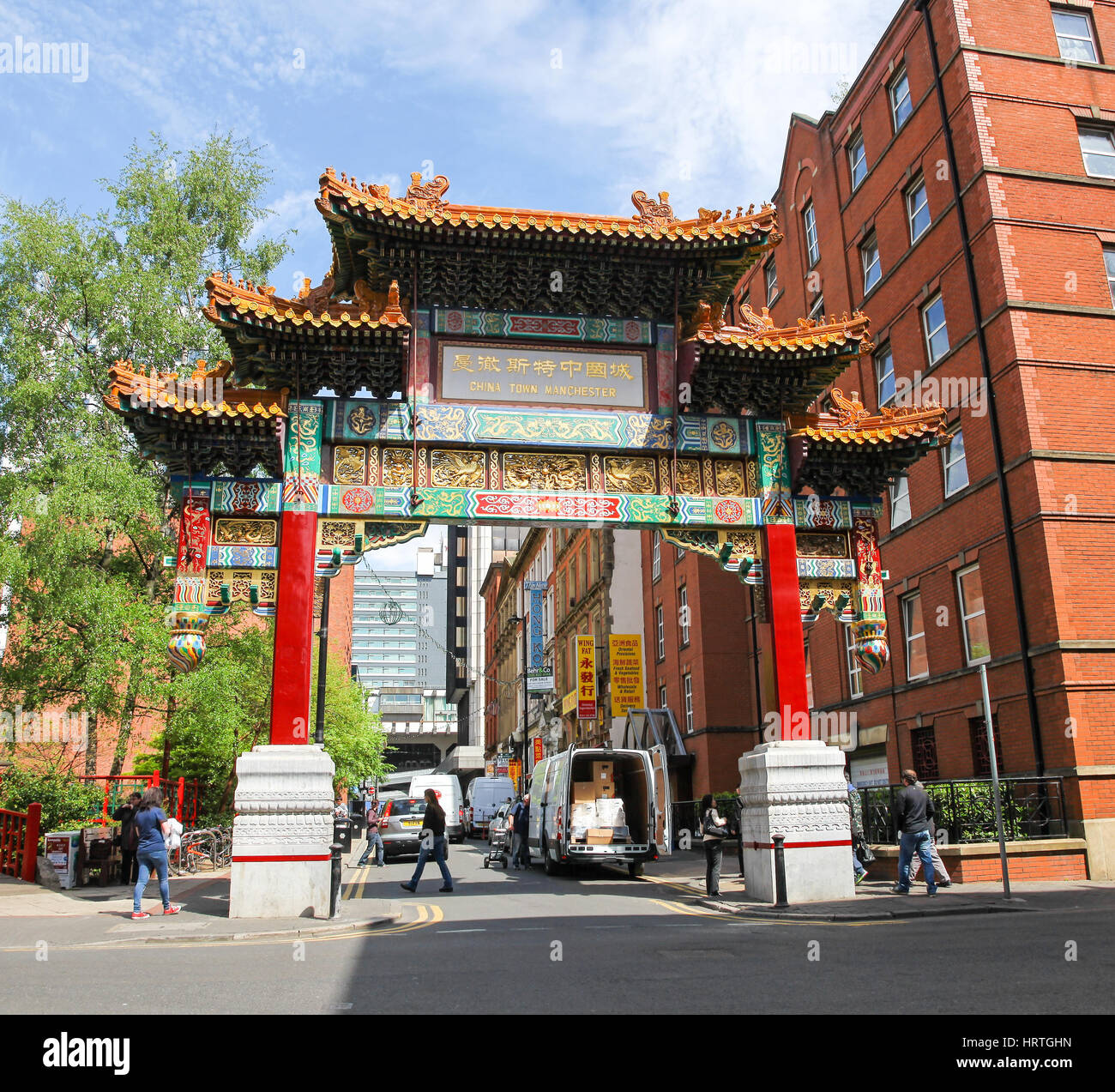The ornate entrance arch to China Town Faulkner Street Manchester city centre Manchester England UK - Stock Image