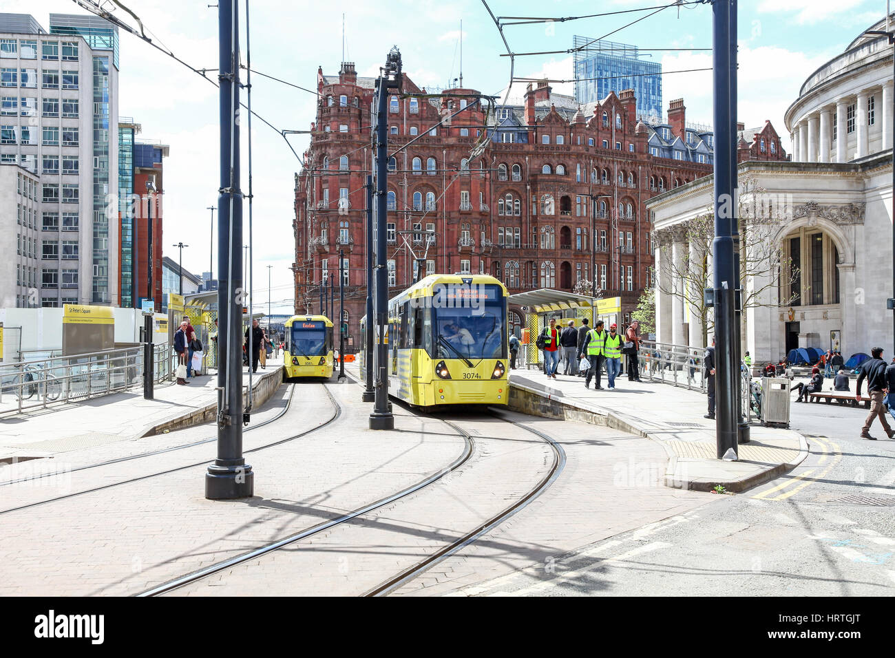 Trams at St. Peter's Square Station Manchester city centre Manchester England UK - Stock Image