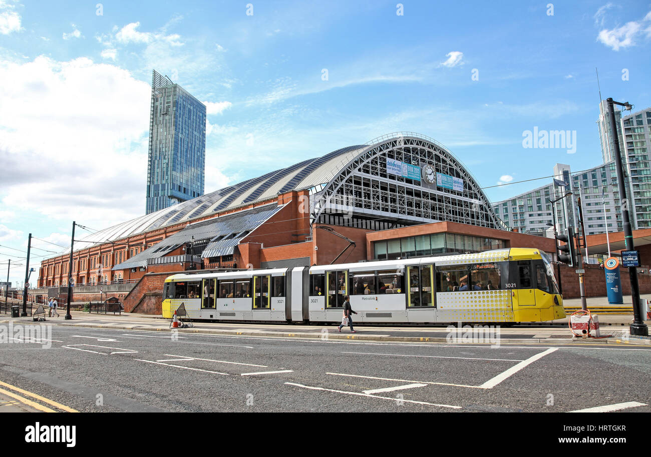Tram in front of the Manchester Central convention complex exhibition and conference centre and Beetham Tower in - Stock Image