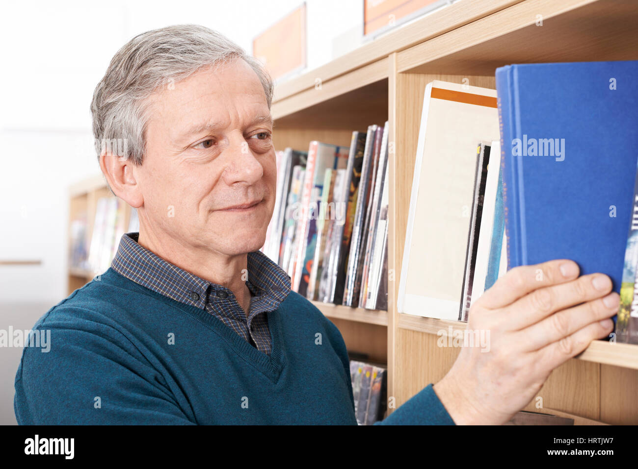 Mature Male Student Studying In Library - Stock Image