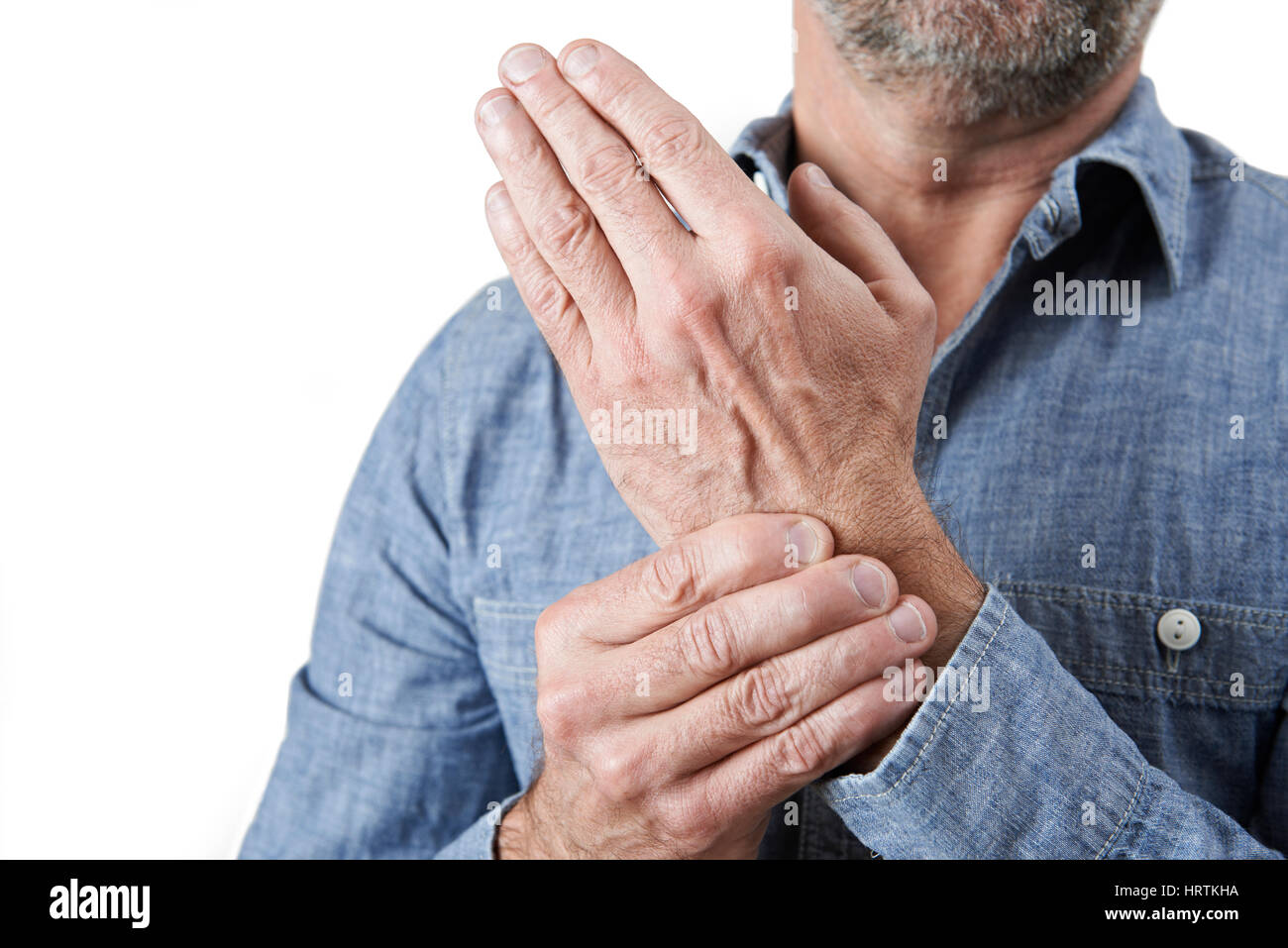 Close Up Shot Of Man Suffering With Repetitive Strain Injury - Stock Image