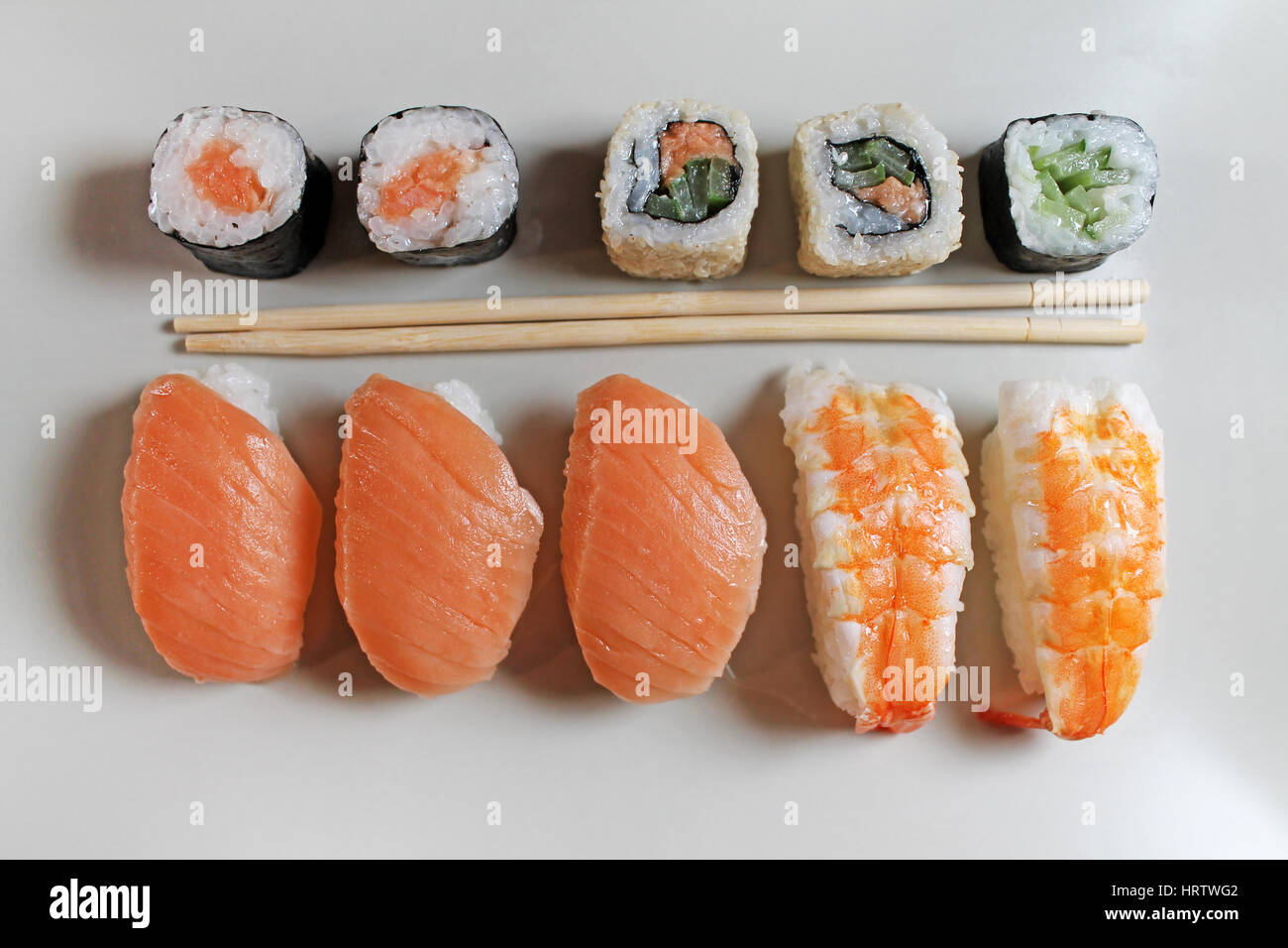 Preparation sushi roll on restaurant - Stock Image