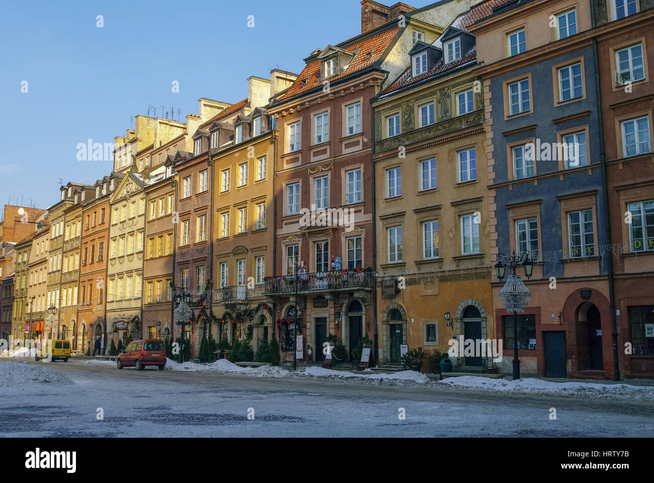 Warsaw, Poland -January 5, 2011: Houses in old town market square, Warsaw, Poland. Winter time with snow - Stock Image