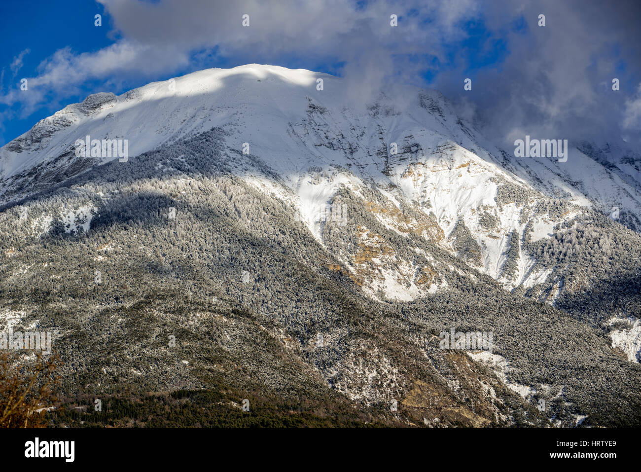 The mountain peak of Les Croix coverred in snow and frost in winter. Saint Andre d'Embrun, Hautes-Alpes, French - Stock Image
