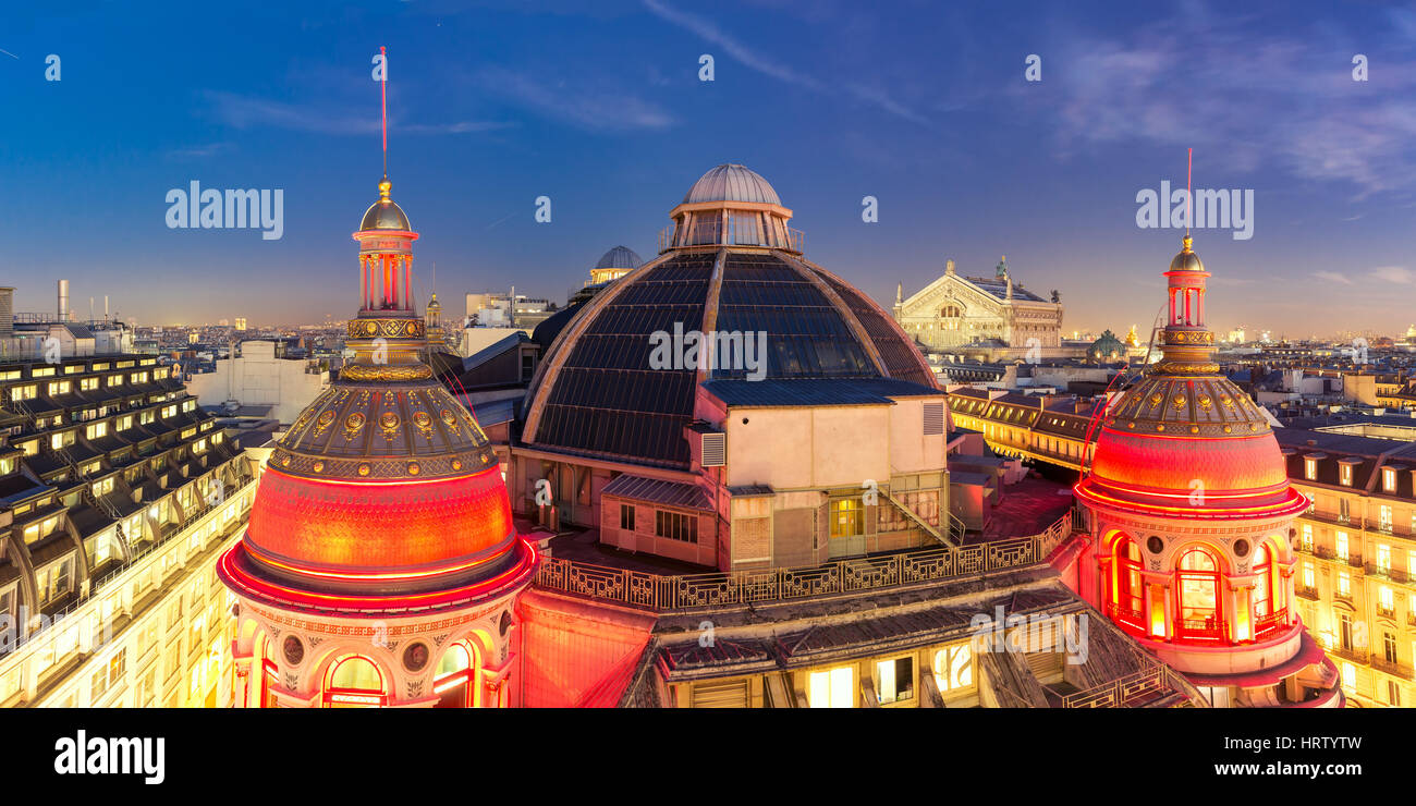 Aerial panoramic view of Opera Garnier, Neo-Renaissance Printemps gallery dome at night, Paris, France - Stock Image