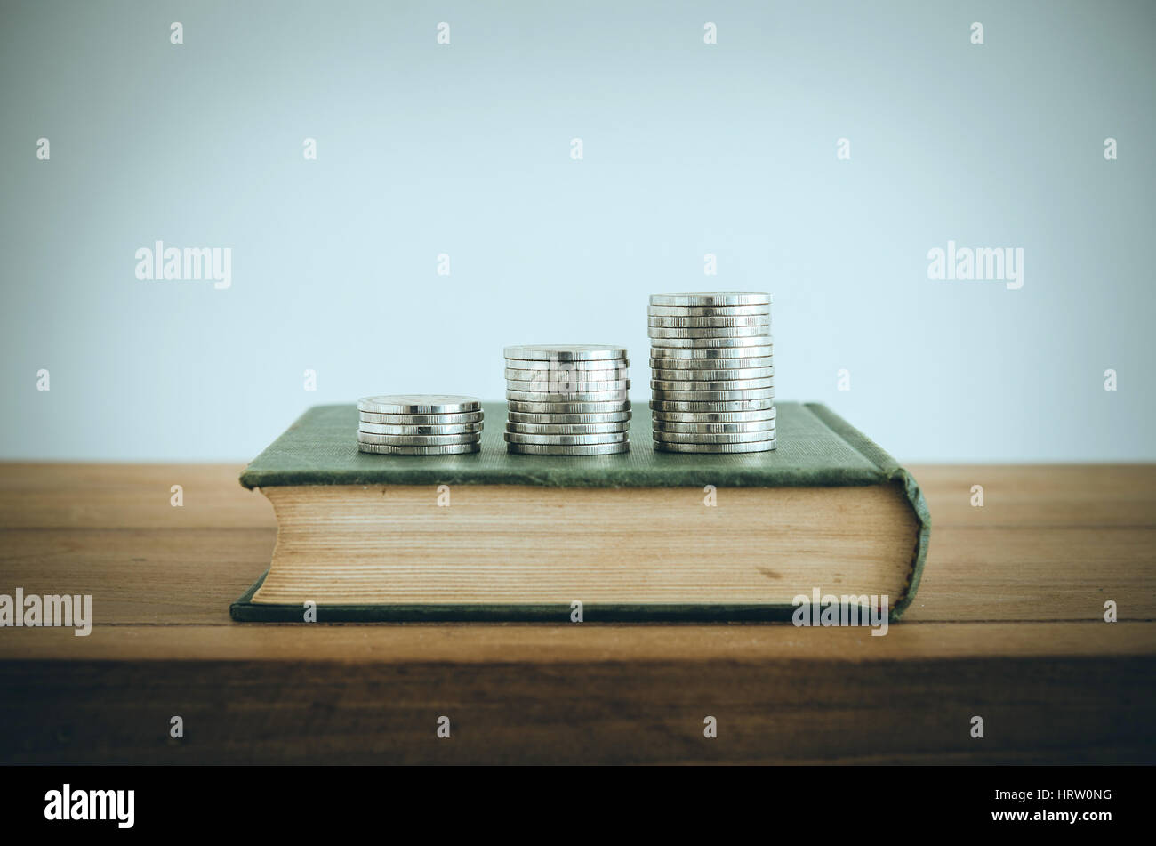 Money, Financial, Business Growth concept, Coin stacks on old book. Vintage filter. - Stock Image