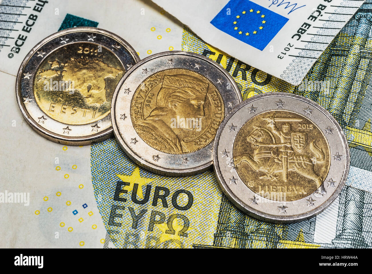 On a 5 euro banknote are the 2 euro coins of the Baltic States, Estonia, Latvia and Lithuania - Stock Image