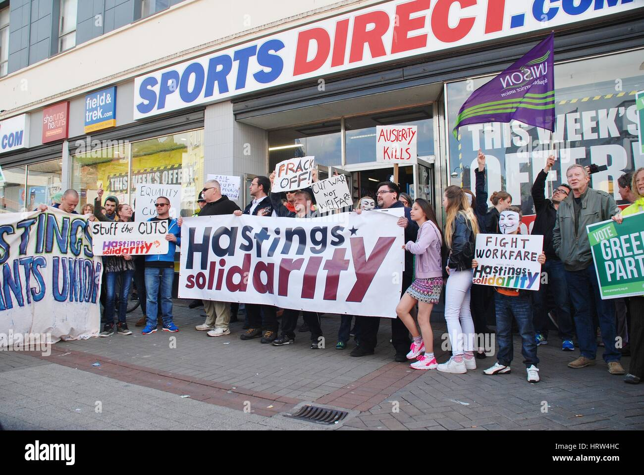 People protest against zero hour contracts outside a branch of Sports Direct following an anti austerity march at - Stock Image