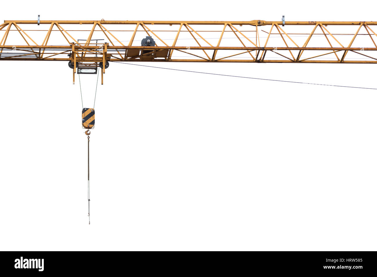 The arm of a yellow crane on a construction site, isolated with a white background - Stock Image