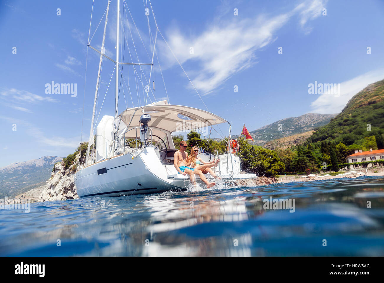 couple yacht honeymoon sailing luxury cruise. View from the water - Stock Image