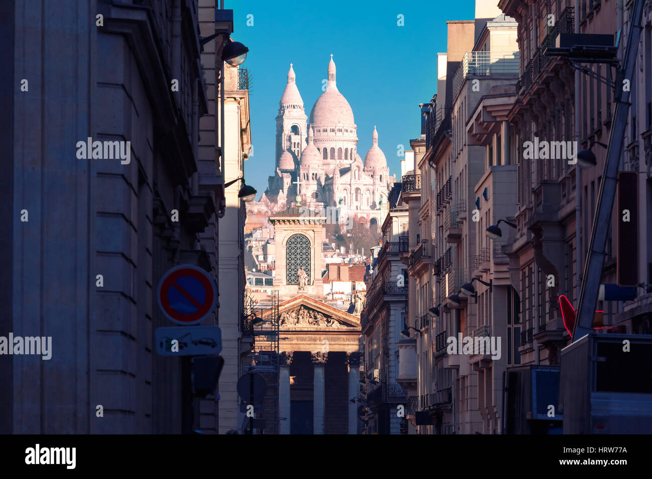 Sacre-Coeur Basilica or Basilica of the Sacred Heart of Jesus and Notre-Dame de Lorette church, seen from Rue Laffitte - Stock Image