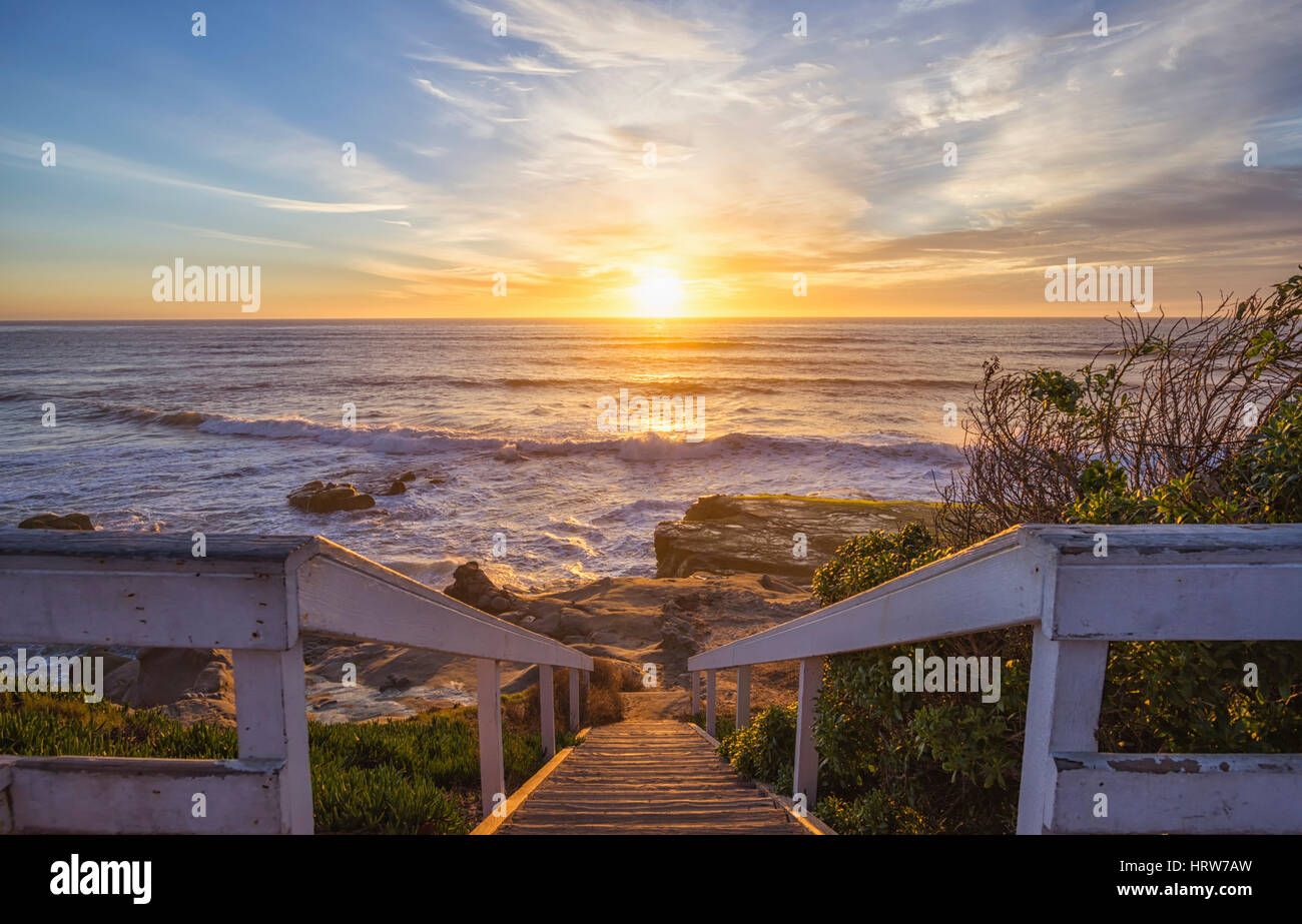Coastal sunset and ocean surf. View from the top of the stairs at Windansea Beach. La Jolla, California, USA. - Stock Image