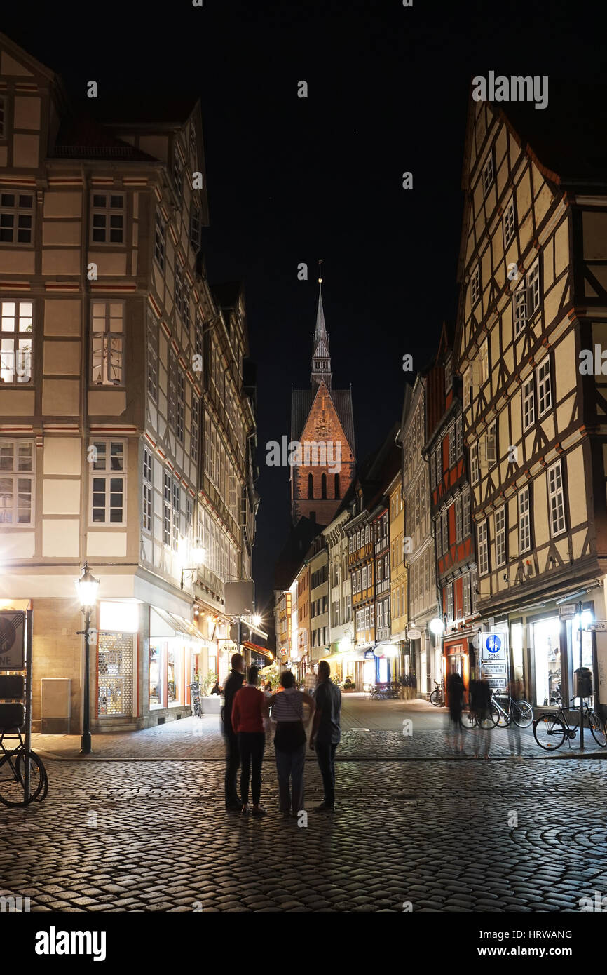 Hannover, Germany - September 9, 2016: Tourists exploring the old town district at night. Pedestrianized Kramerstrasse - Stock Image