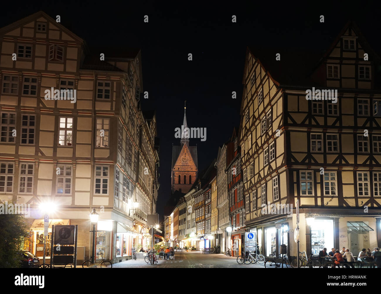 Hannover, Germany - September 9, 2016: Historic old town district with its half-timbered houses and a view of Marktkirche - Stock Image