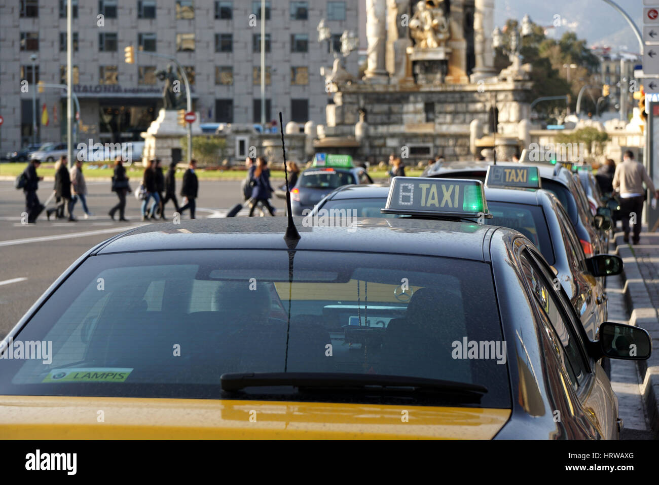 Barcelona, Spain - Feb 29, 2016: Row of taxi cabs waiting for passengers at Placa d'Espagna. - Stock Image