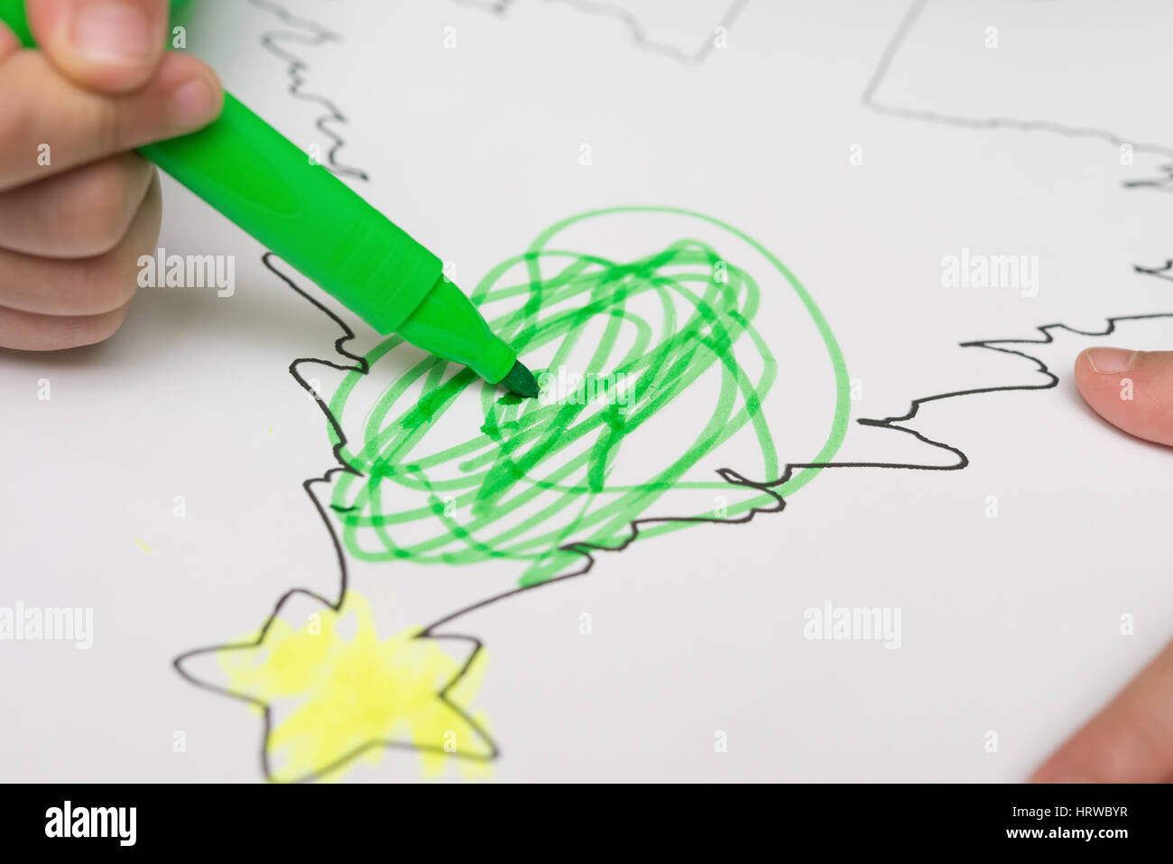 boy drawing a Christmas tree with color pens Stock Photo: 135167867 ...
