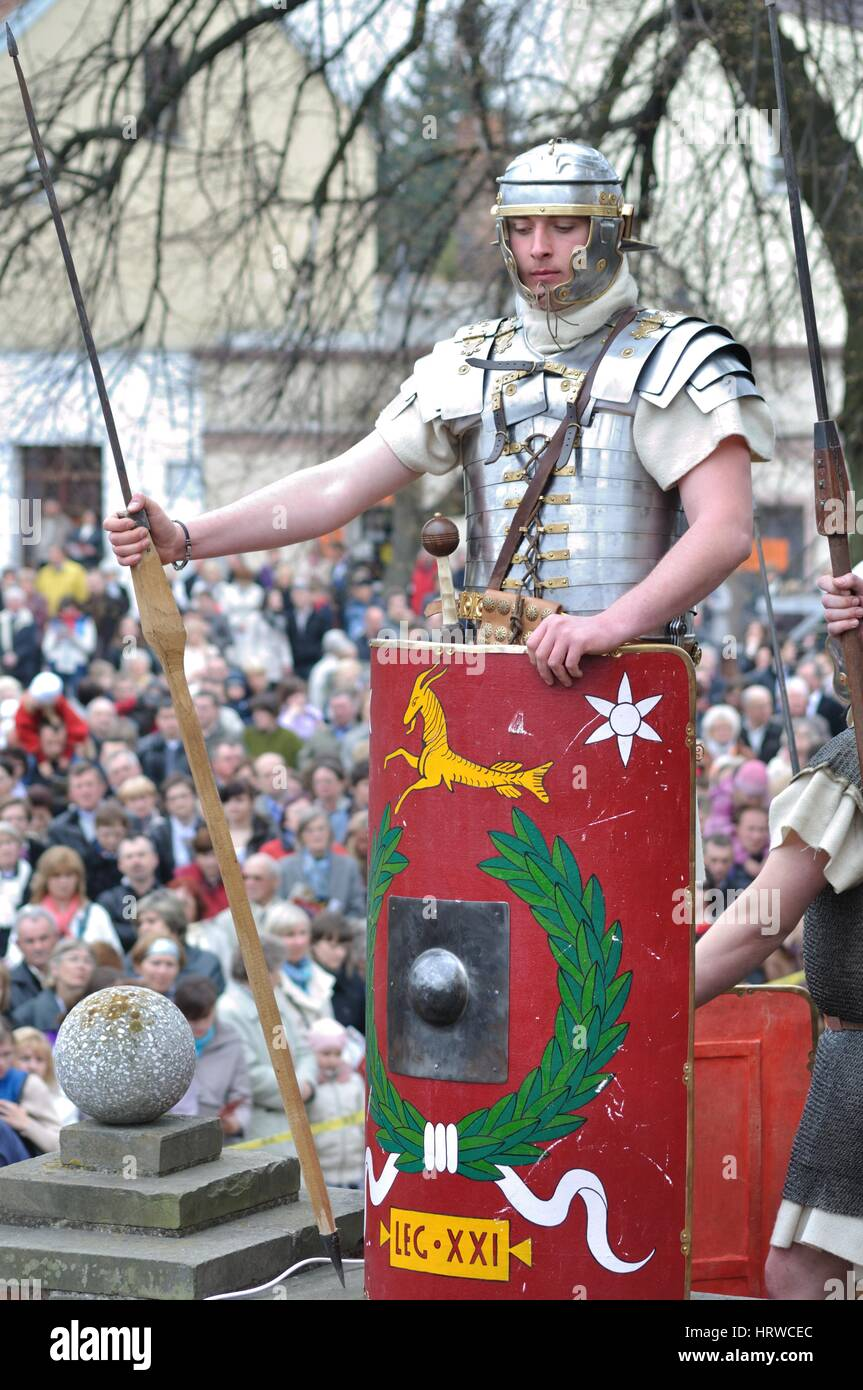 Reenactment of the Roman legionary, standing on guard, during the street performances Mystery of the Passion. - Stock Image