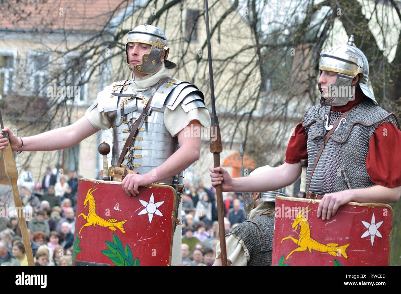 Reenactment of the Roman legionaries, standing on guard, during the street performances Mystery of the Passion. - Stock Image