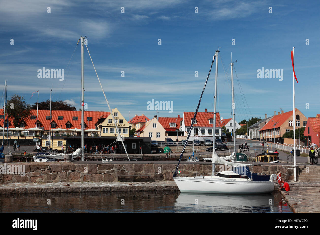 Fishing boats moored in the harbour at Svaneke, a small town on the east coast of the Baltic island of Bornholm, Stock Photo