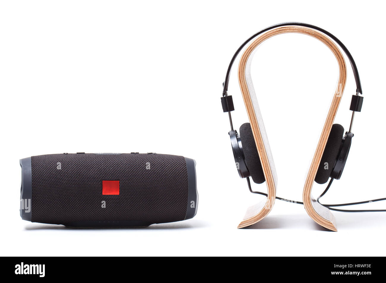 headphones in black and wireless portable speaker system on a white background. isolated Stock Photo