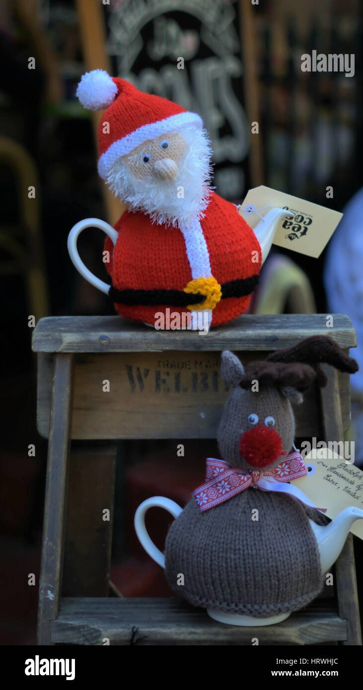 Teapot in Cosy. Teapot in Santa Claus cosy - Stock Image