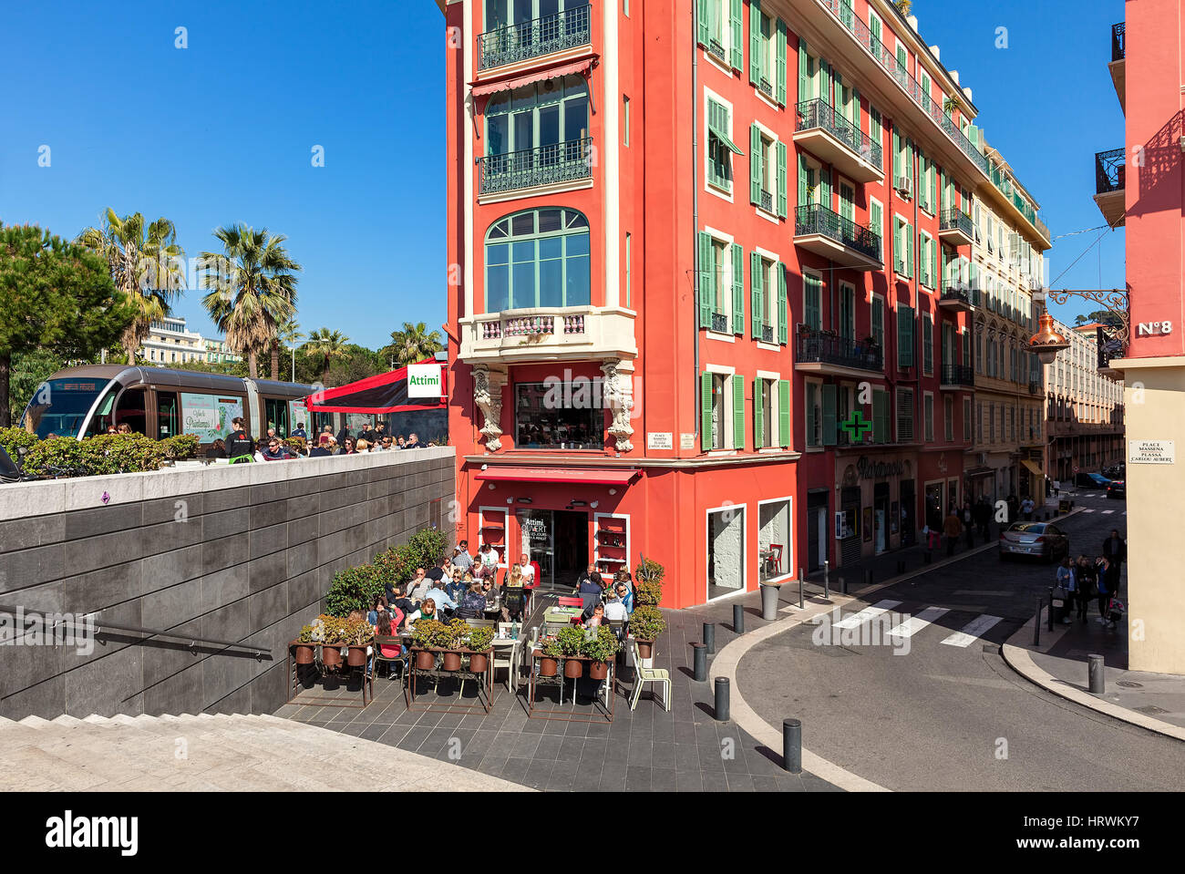 NICE, FRANCE - MARCH 26, 2016: Unusual red building and outdoor restaurant on Place massena in Nice - fifth most - Stock Image